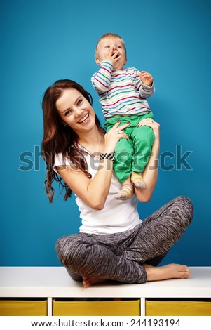 Mother and her baby boy - stock photo