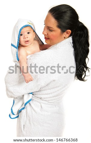 Mother and her baby boy in bathrobes after bath isolated on white background - stock photo