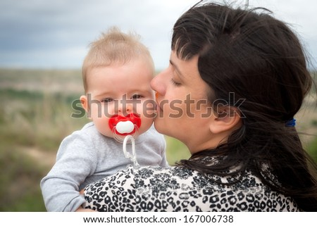 Mother and her baby in a portrait outdoors