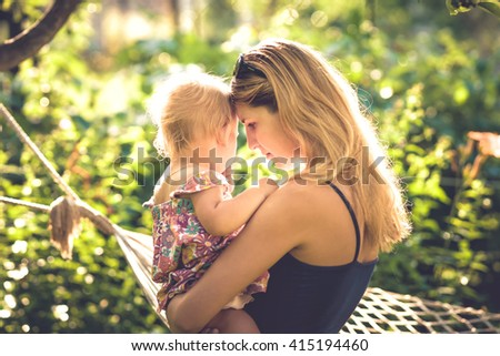 Mother and her child - stock photo