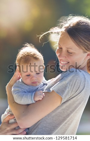 Mother and her child enjoy the early spring - stock photo