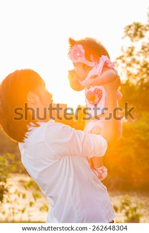 Mother and her child enjoy the early summer - stock photo