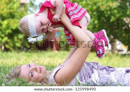 Mother and her child in the park - stock photo