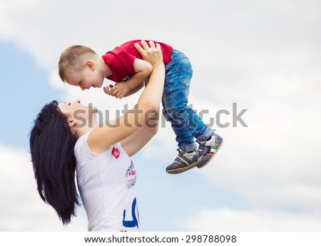Mother and her child play outdoors