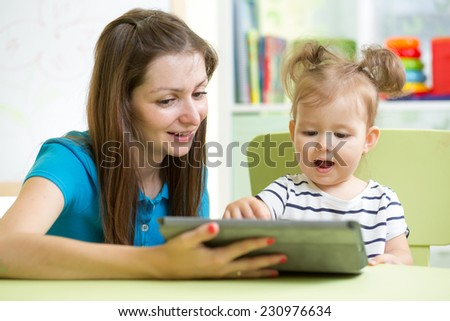mother and her child with tablet pc