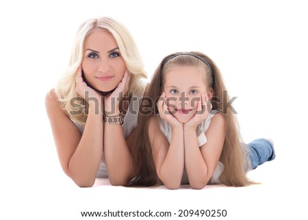 mother and her daughter lying on the floor isolated on white background