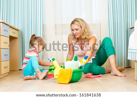 mother and her daughter ready to room cleaning - stock photo