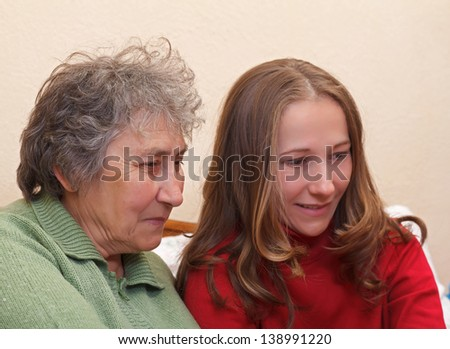 Mother and her daughter surfing on the internet - stock photo