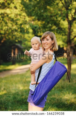 Mother and her daugther going for yoga class - stock photo