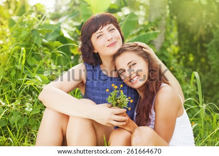 mother and her grown up daughter - stock photo