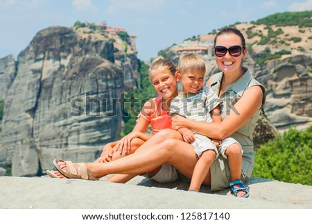Mother and her kids looking at the town of Kalambaka bird's eye view. Meteora, Greece. - stock photo