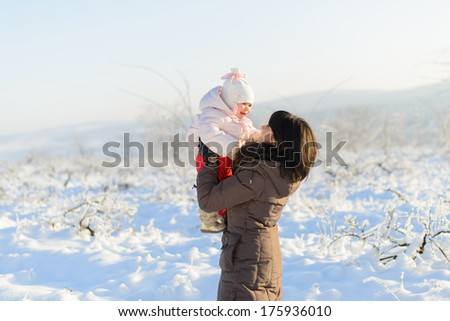mother and her laughing daughter having fun - stock photo
