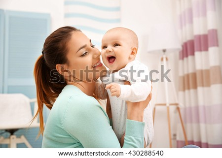 Mother and her little baby at home - stock photo