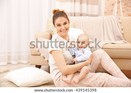 Mother and her little baby at home