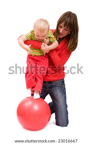 Mother and her little daughter doing exercises. Isolated over white