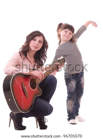 Mother and her little daughter with guitar