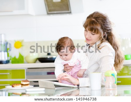 mother and her little daughter with tablet pc  - stock photo