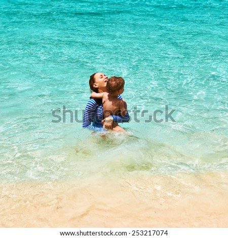 Mother and her little son at the tropical beach - stock photo