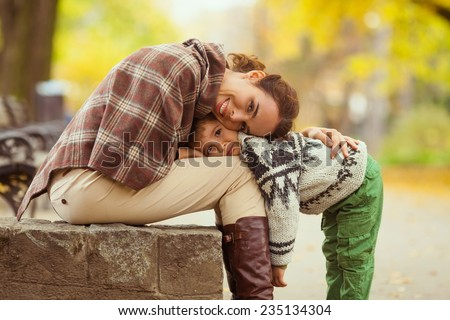 Mother and her little son in a park - stock photo