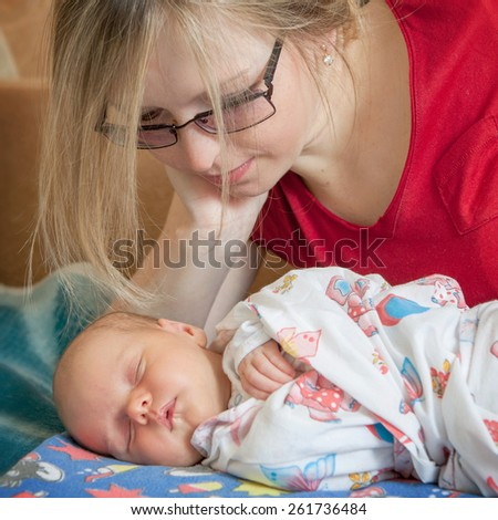 Mother and her Newborn Baby. Happy Mother and Baby kissing.  soft image of Beautiful Family. Maternity concept. Parenthood. Motherhood. - stock photo