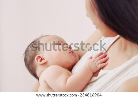 mother and her newborn baby, maternity concept, soft image of beautiful family - stock photo