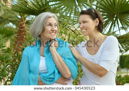 Mother and her nice daughter in  park