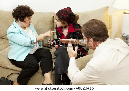 Mother and her rebellious teen daughter fighting while the counselor calls for a time out. - stock photo