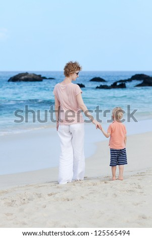 mother and her son at a big island beach