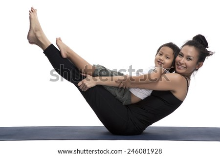 Mother and her son doing yoga exercise on studio white background. - stock photo