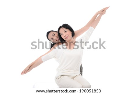 mother and her teenager girl having a fun - stock photo