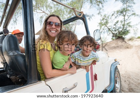 Mother and her two sons having fun during extreme ride