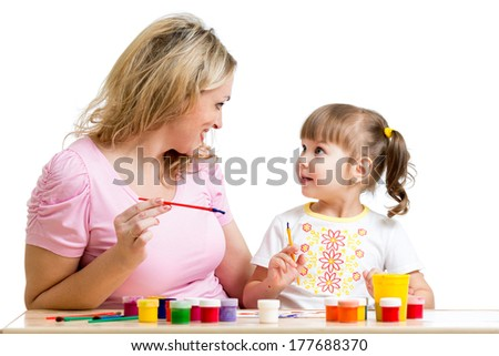 Mother and kid girl paint together