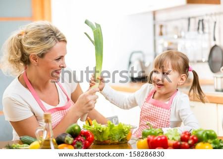 mother and kid  having fun preparing healthy food - stock photo