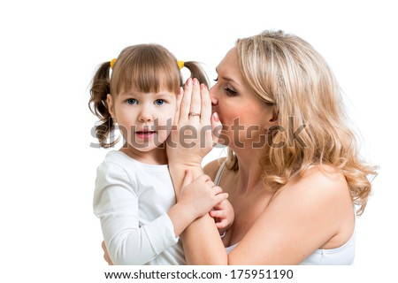 mother and kid sharing a secret whispering - stock photo