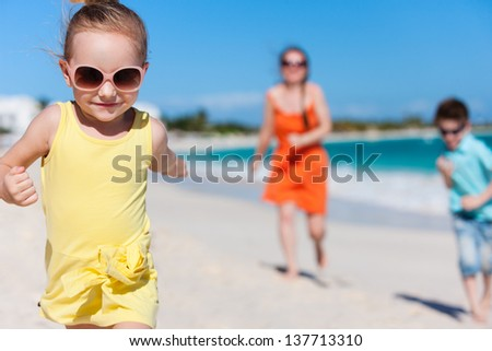 Mother and kids enjoying Caribbean vacation - stock photo