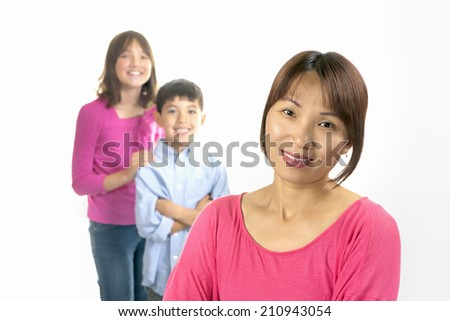 Mother and kids smiling. - stock photo