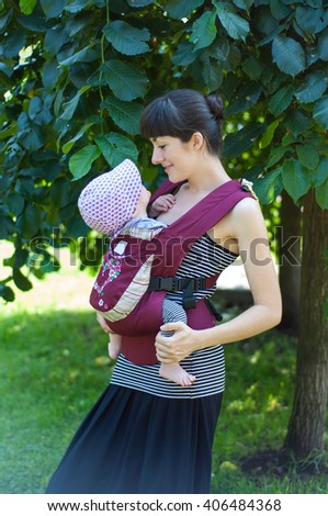 Mother and little baby child in her arms - stock photo