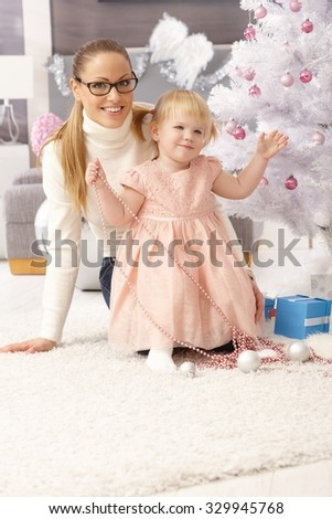 Mother and little daughter celebrating christmas.