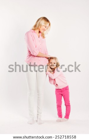 mother and little daughter full length portrait on white - stock photo