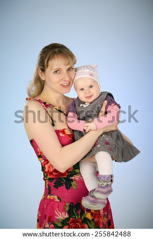 mother and little daughter in a studio - stock photo