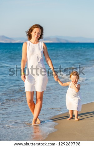 Mother and little daughter on the beach