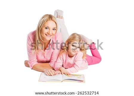 Mother and little daughter reading book on white - stock photo