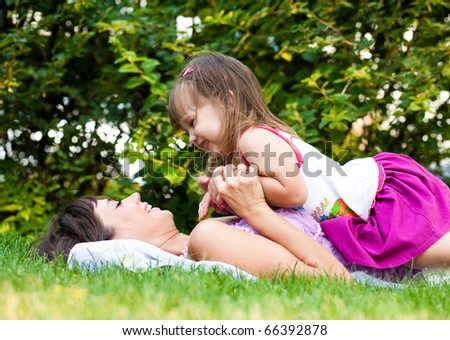 Mother and little girl on meadow