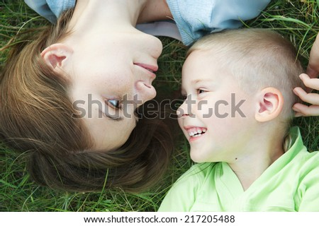 Mother and little son on the grass