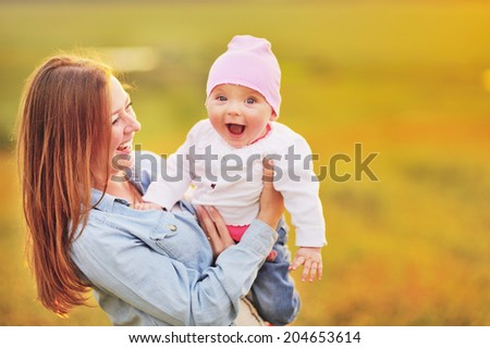 Mother and lovely daughter. Sunny summer weather. - stock photo