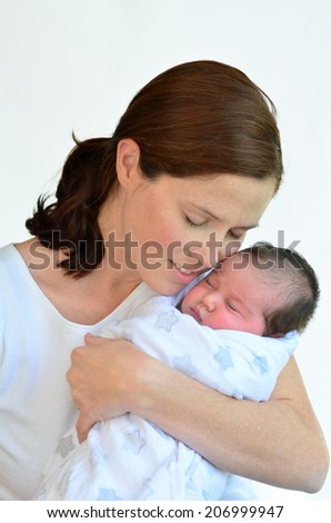 Mother and newborn baby kissing and hugging. concept photo happy family, motherhood, newborn, baby, lifestyle.