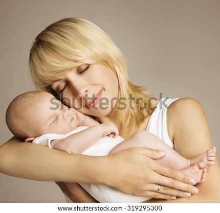 Mother and Newborn Baby, Mother with Sleeping New Born Kid, Family Love Care Happiness - stock photo