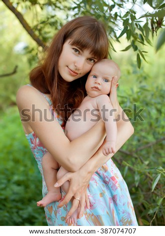 mother and newborn son in the park. Breast newborn. Breast engorgement.