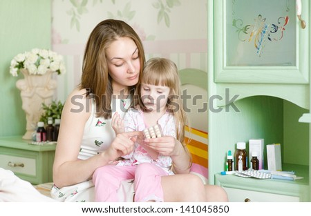 mother and sick girl - stock photo