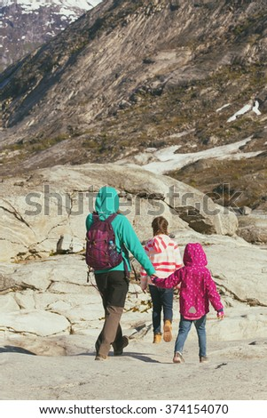 mother and sisters hiking at the mountains  - stock photo